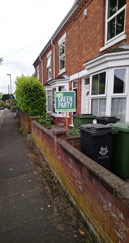Green signboard in front garden