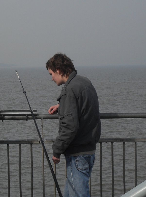 Maurice on the pier at Southwold, talking to a fisherman
