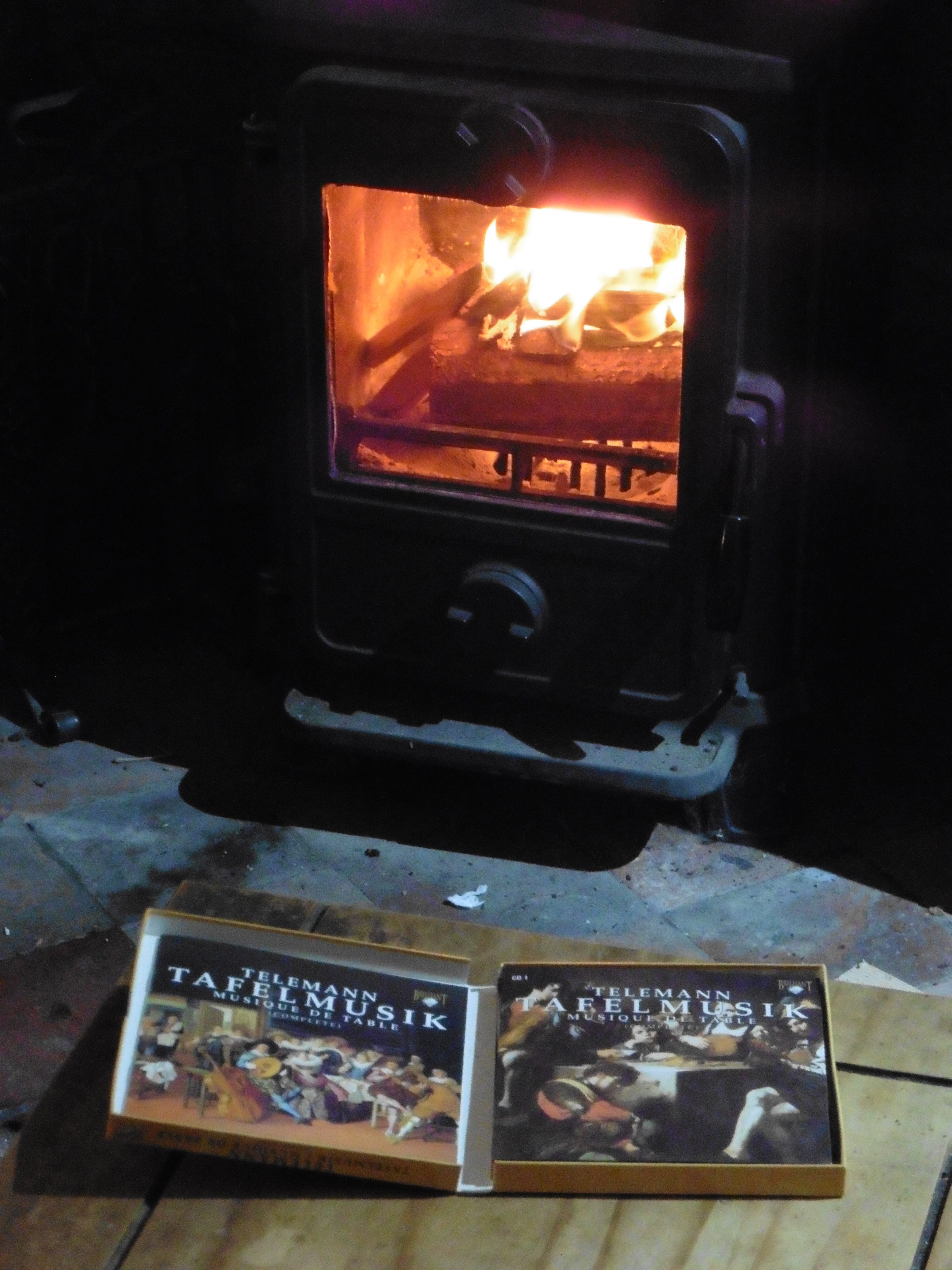 fire, CD cover in foreground